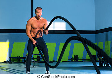 cross fit battling ropes at gym workout exercise - cross fit...