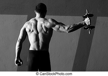 Dumbbell man rear view with back muscles