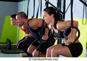 Cross fit dip ring group workout dipping in a row - Cross...