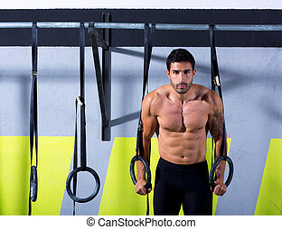 Cross fit dip ring man workout at gym dipping exercise