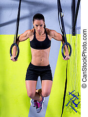 Cross fit dip ring woman workout at gym dipping exercise