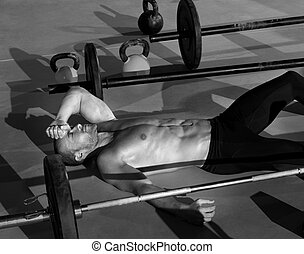 cross fit man tired relaxed after workout exercise