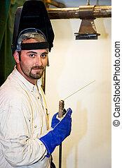 Handsome Welder - Portrait of a handsome welder on the job....