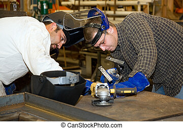 Welders Teamwork - Two welders working together on a...
