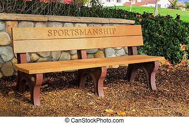 "park bench with ""sportsmanship"" - outside bench with the..."