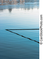 Abstract photo of a cable in the water
