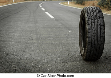 Car tire on the road outdoors