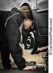 Young man in the middle of a car repair