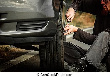 Young man repairing car
