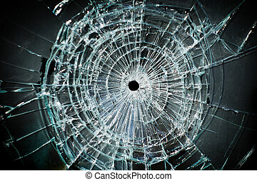 broken window - Broken window with a bullet hole in the...