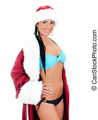Young sexy woman in santa clause costume. Isolated on white...