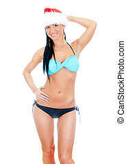Young sexy woman wearing bikini and christmas hat Isolated...