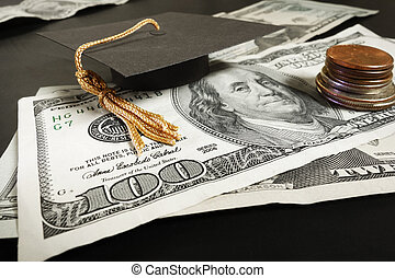 Education money - Mini graduation cap mortar board on cash...