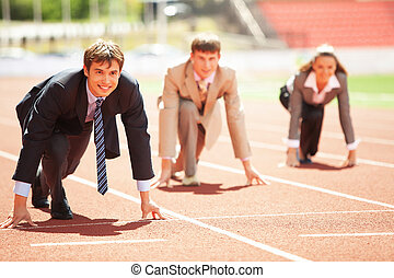 Business Competition - Businessmen running on track racing...