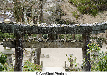 Torii gate with stones on top - Stone torii gate in Japan...
