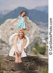 jumping angel over mountains