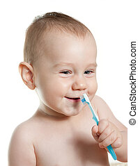 Cute baby cleaning teeth and smile