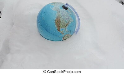 hand earth globe snow - earth globe sphere lie in winter...