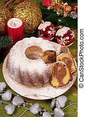 Christmas cake with decoration in background