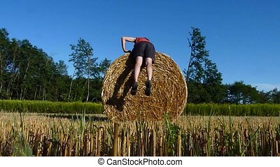 hay bale fitness - man doing a lumbar exercise on a hay bale
