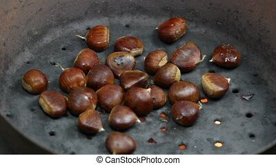 cooking chestnut  - 	close up of roasted chestnuts