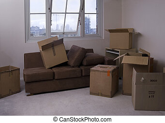 moving house - unpacking boxes after moving into a new...