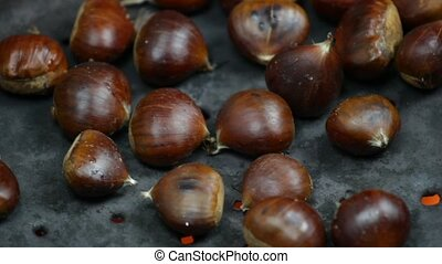 chestnut cooking - close up of roasted chestnuts