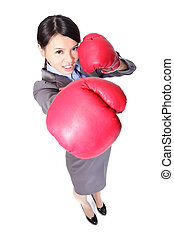 Business woman boxing punching towards ready to fight in...