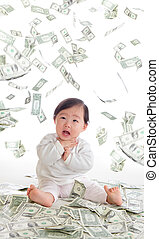 baby surprised funny face with money rain