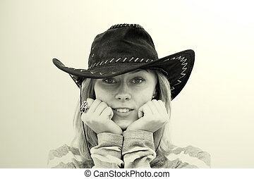 Girl in a cowboy hat - Smiling girl in a cowboy hat