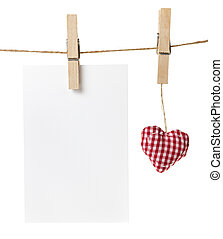 blank card and fabric heart, isolated on white