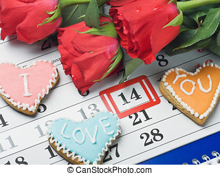 I love you - red roses lay on the calendar with the date of...