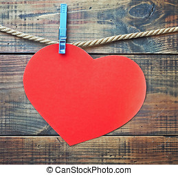 red heart made of paper with a place for text greetings