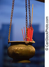 Chinese urn with incense sticks