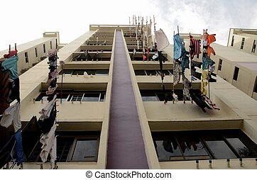 Drying laundry from window - Clothes hanging from poles at...