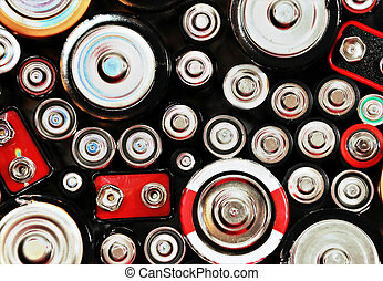 Abstract Batteries Background - The tops of batteries are...