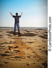 Happy Freedom Man Standing on Beach - A man is standing on a...