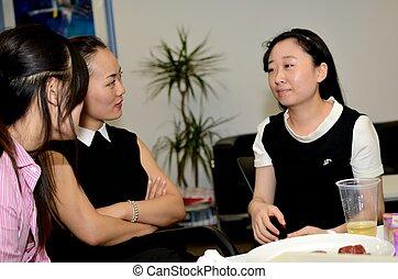 Three women chatting during their break