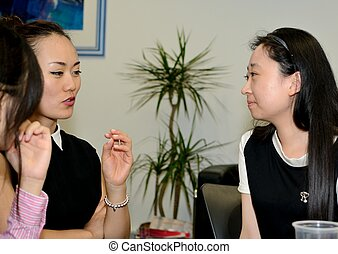 Office gossip - Discussing office politics together