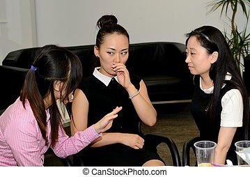 Three friends chatting