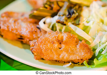 deep fried chicken with fried garlic  and fresh vegetable