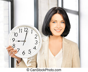 attractive businesswoman with clock - bright picture of...