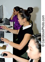 Three computer team members - Three young ladies in the...