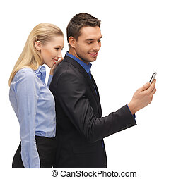 man and woman reading sms - bright picture of man and woman...