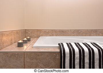 Bathtub, striped towel and candle lights - Modern bathroom...