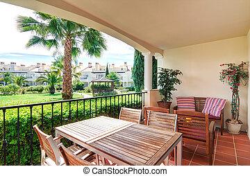 Veranda estates with views the green garden.