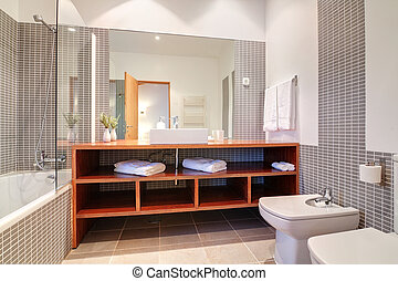 Bathroom with sink and bidet and towels.