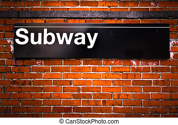 Subway - New York City subway sign entrance on brick wall