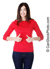 Beautiful young woman gesturing thumbs up - Beautiful young...