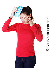 Woman with ice bag for headaches and migraines , isolated on...
